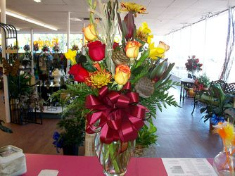 Mixed Vase Arrangement in Fall Colors  from Bunn Flowers & Gifts, local florist in Pittsburg, TX