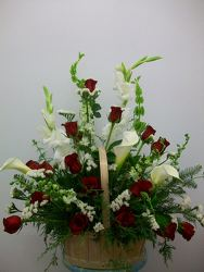Basket of roses, callas and assorted mixed flowers from Bunn Flowers & Gifts, local florist in Pittsburg, TX