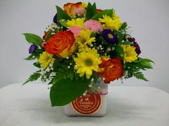 Circle E Candle with fresh flower arrangement on top from Bunn Flowers & Gifts, local florist in Pittsburg, TX