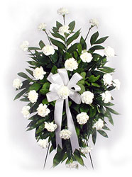 Standing spray of white carnations from Bunn Flowers & Gifts, local florist in Pittsburg, TX