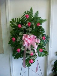 Standing spray of pink roses from Bunn Flowers & Gifts, local florist in Pittsburg, TX