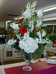 Red and white arrangement in large elegant crystal vase from Bunn Flowers & Gifts, local florist in Pittsburg, TX
