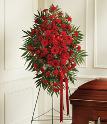 Standing spray of mixed red flowers from Bunn Flowers & Gifts, local florist in Pittsburg, TX