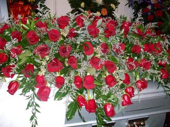 Casket spray of red roses from Bunn Flowers & Gifts, local florist in Pittsburg, TX