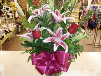 Red roses and lilies from Bunn Flowers & Gifts, local florist in Pittsburg, TX