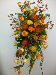 Standing spray of assorted seasonal and tropical flowers from Bunn Flowers & Gifts, local florist in Pittsburg, TX
